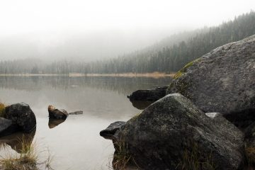 Fog hangs over the still waters of Lake Janus in Jackson Wilderness.