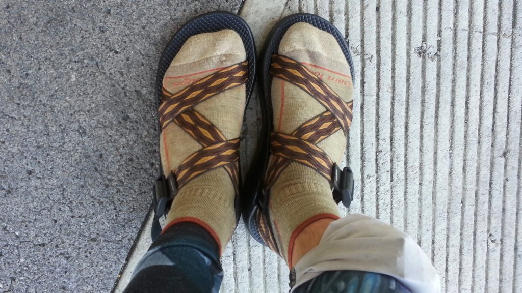 Wearing a pair of Chaco Sandals and Darn Tough socks for backpacking on the Pacific Crest Trail.
