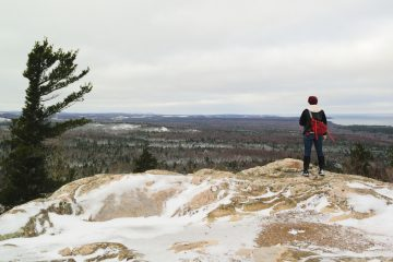 Standing on the wintery top of the Hogback Mountain summit near Marquette Michigan