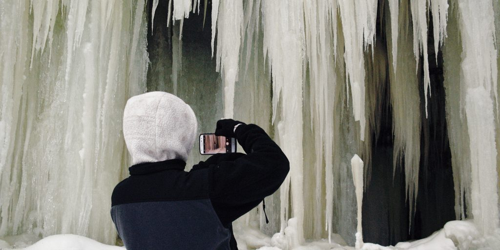 Taking a picture of the Eben Ice Caves.